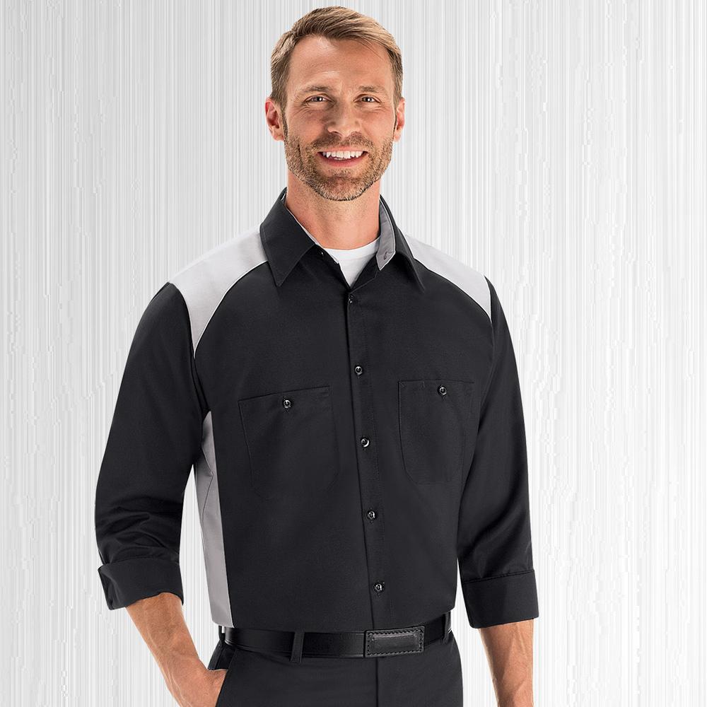 Employee wearing black and grey Dempsey Uniform motorsport shirt