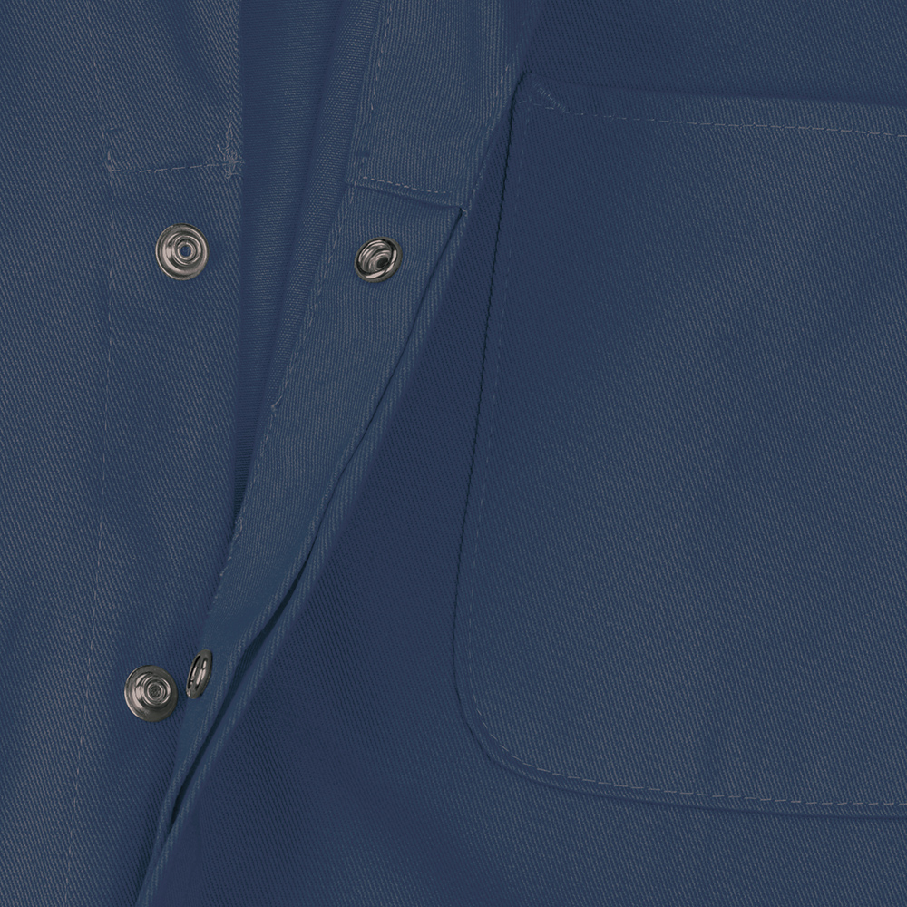 Close-up view of Dempsey Uniform 100% cotton coveralls with a concealed snap front