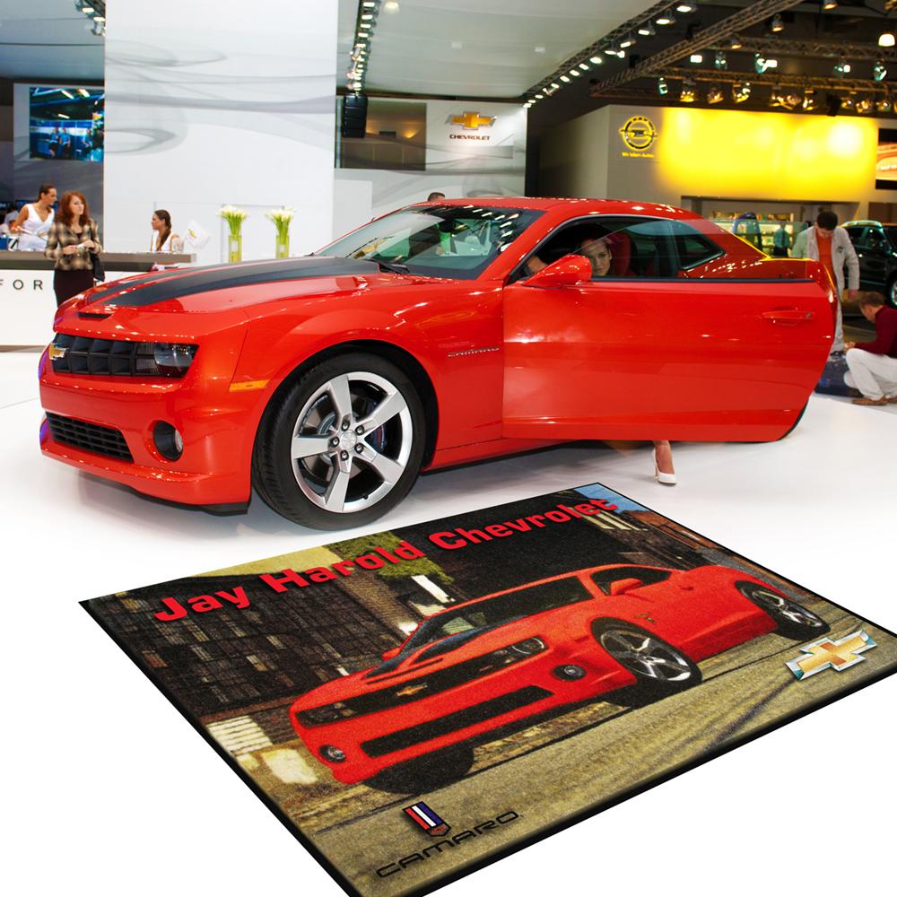 Dempsey Uniform custom logo mat on an automobile showroom floor