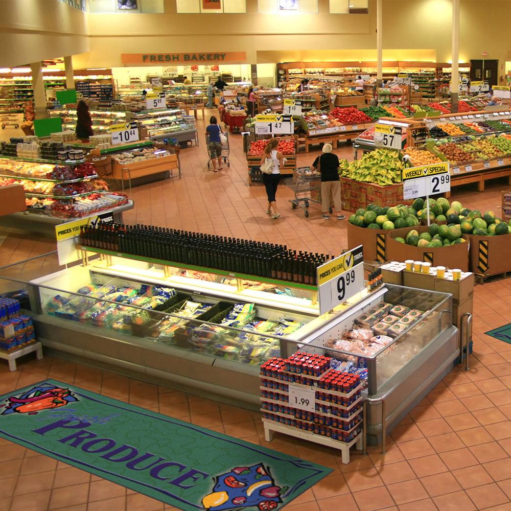 Dempsey Uniform deli message mat in a produce section