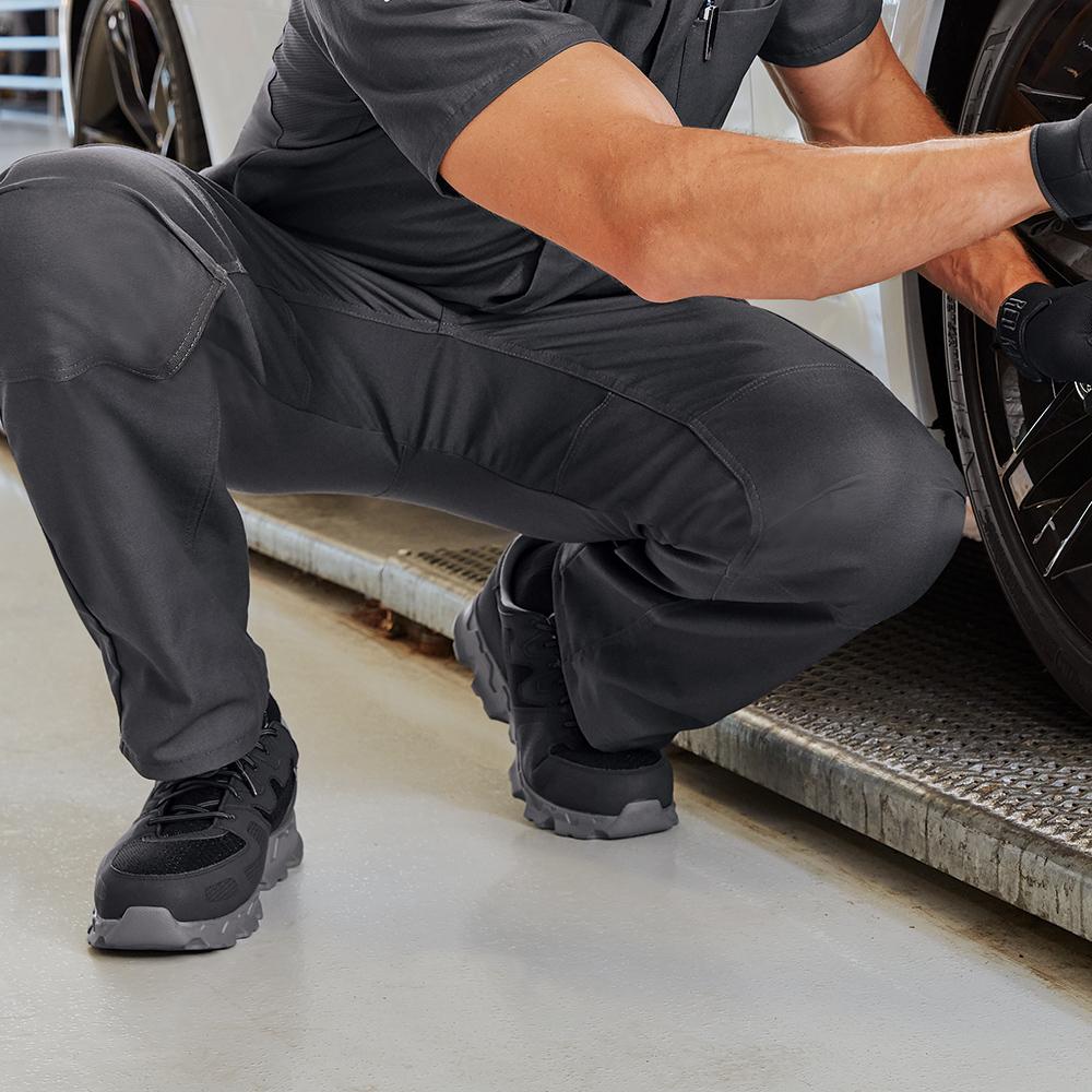 Mechanic wearing Dempsey Uniform Performance Cargo Pants