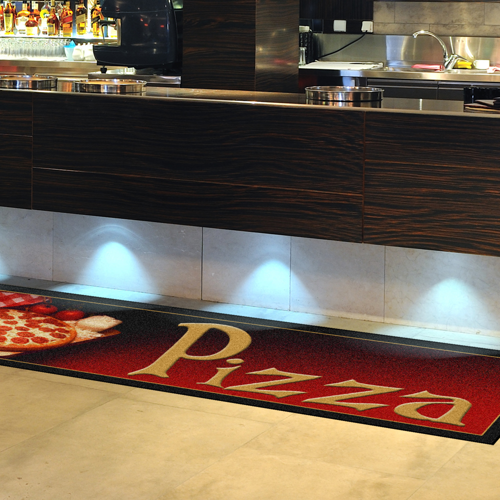 Dempsey Uniform pizza message mat in front of a counter