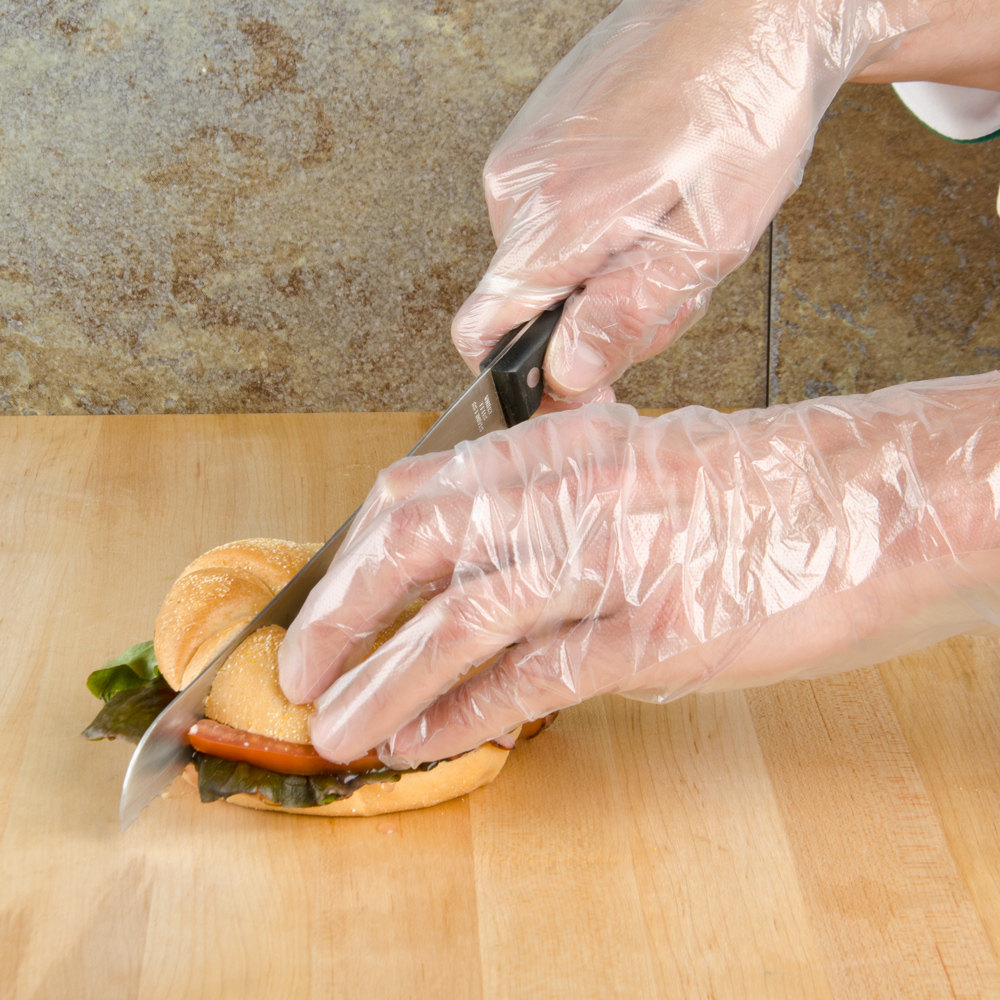 Food service worker wearing Dempsey Uniform poly disposable gloves