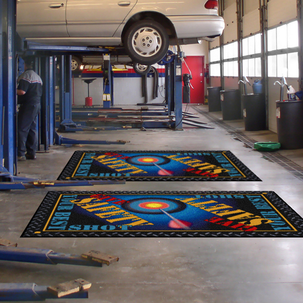 Dempsey Uniform safety message mats in an automotive shop