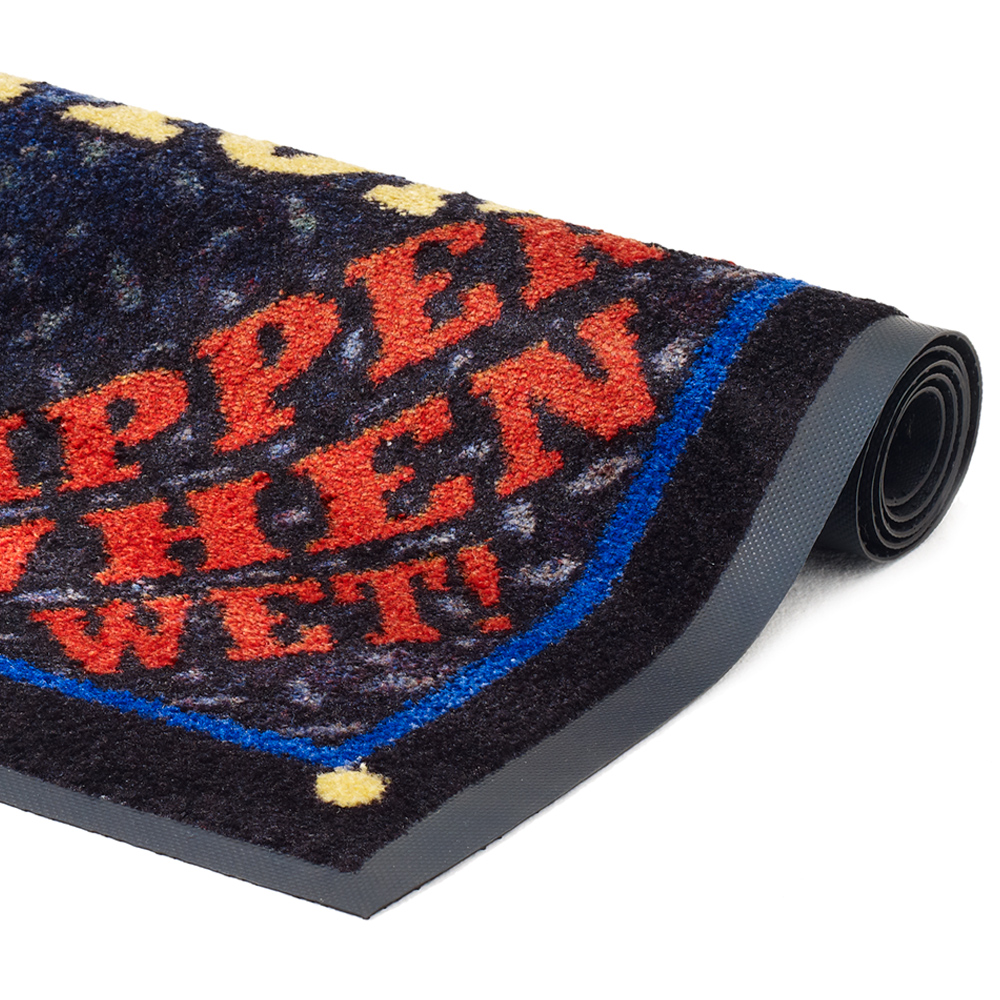 Close-up view of a Dempsey Uniform safety message mat