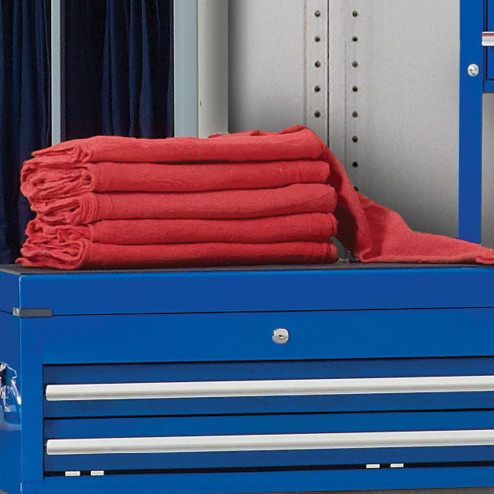 Stack of Dempsey Uniform shop towels on a tool box