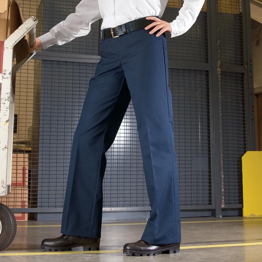 Employee wearing navy Dempsey Uniform womens work pants